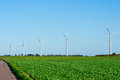Windturbines on field standing a Royalty Free Stock Photo