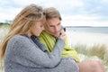 Windy autumn days relaxing on coast - sand dune, beach, beautiful couple Royalty Free Stock Photo