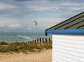 Windy bay at the beach a lone kite boarder and hut in whitstable kent uk Stock Photography