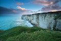 Windy sunrise over cliff in atlantic ocean etretat normandy france Royalty Free Stock Image