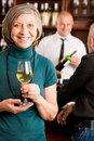 Wine bar senior woman barman discussing Royalty Free Stock Photography