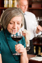 Wine bar senior woman taste wine glass Royalty Free Stock Photo