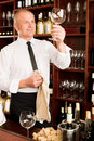 Wine bar waiter clean glass in restaurant Royalty Free Stock Images