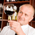 Wine bar waiter looking at glass restaurant Royalty Free Stock Images