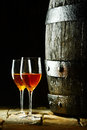 Wine barrel with glasses of sherry old oak two against a dark background reminiscent a cellar in a winery Royalty Free Stock Photos