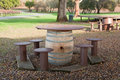 Wine barrel picnic table a made from a used a wooden top and wooden stools sits outside at a california vineyard Stock Photo