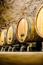 Wine barrels in an aging cellar Royalty Free Stock Photo