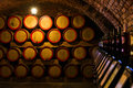 Wine barrels in the antique cellar. Cavernous wine Royalty Free Stock Photo