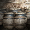 Wine barrels on wooden background Royalty Free Stock Image
