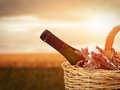 Wine in basket bottle of against beautiful landscape Stock Photo