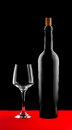 Wine bottle and glass silhouette with high contrast on red and black Royalty Free Stock Photo