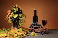 Wine bottle and grapes on the table Royalty Free Stock Photography