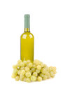 Wine bottle with green grapes Stock Photography