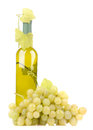 Wine bottle with green grapes Stock Image