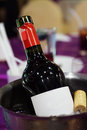 Wine bottle in ice bucket with blur background Royalty Free Stock Photo