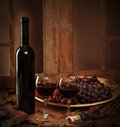 Wine bottle with a two glasses of red wine with grapes Royalty Free Stock Photos