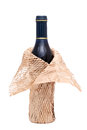 Wine bottle with wrapping paper isolated on white background Stock Images