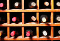 Wine bottles in cells Royalty Free Stock Images