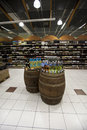 Wine bottles italian store barrels and shelves. Royalty Free Stock Photo