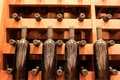 Wine bottles old placed on wooden shelves in the cellar Royalty Free Stock Photography