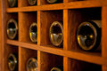 Wine bottles rack wooden in the french restaurant Stock Images