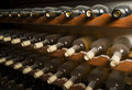 Wine bottles on shelf cellar close up Royalty Free Stock Image