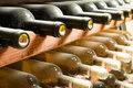 Wine bottles on shelf cellar close up Stock Photos