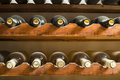 Wine bottles on shelf cellar close up Stock Images