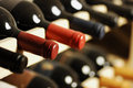 Wine bottles stored in a shelf very shallof dof Royalty Free Stock Photo