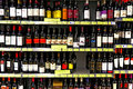Wine bottles at supermarket assorted brands of for sales a Stock Photos