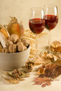 Wine and bowl of nuts Royalty Free Stock Photos
