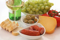 Wine, bread, cheese and vegies Stock Photo