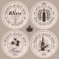 Wine casks four labels for on wooden Royalty Free Stock Image