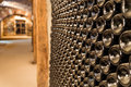 Wine cellar a row of champagne bottles stocked in Royalty Free Stock Images