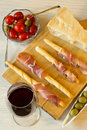 Wine with cheese, olives, tomatoes, prosciutto Royalty Free Stock Photo