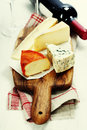 Wine and cheese over white Stock Photo