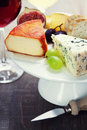 Wine and cheese plate close up image Royalty Free Stock Photos