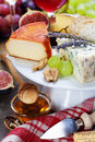 Wine and cheese plate close up image Stock Image
