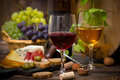 Wine and cheese on the table Stock Image
