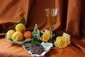 Wine chocolate and peaches glass of white roses bar Stock Photos
