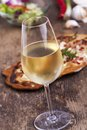 Wine closeup of white and flammkuchen Royalty Free Stock Photos