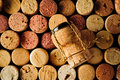 Wine corks and champagne cork background with different Royalty Free Stock Photo