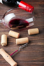 Wine corks, corkscrew and glass with a red wine Royalty Free Stock Photo