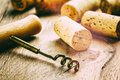 Wine corks and corkscrew on wooden table Stock Photography