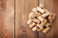 Wine corks heap over rustic wooden table background Royalty Free Stock Photo