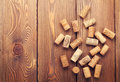 Wine corks over rustic wooden table background Royalty Free Stock Photo