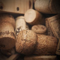 Wine corks various used in a wooden box Royalty Free Stock Photos