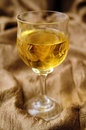 Wine in crystal glass white and golden backcloth Royalty Free Stock Photo