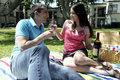 Wine dine picnic young couple having a romantic with Royalty Free Stock Photography