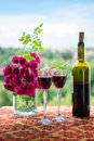 Wine and flowers. Royalty Free Stock Photo